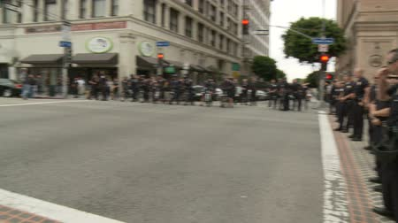 investigar : LAPD Officers Crowd Control. Officers wait at a blockade for protesters of the Occupy Movement in downtown Los Angeles, California on May 1st, 2012.