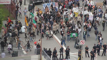 oy : Occupy Marches On. Protesters for the Occupy Movement march in downtown Los Angeles, California on May 1st, 2012.