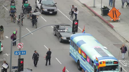 gays : Police Tail Occupy March. LAPD follow protesters for the Occupy Movement in downtown Los Angeles, California on May 1st, 2012. Stock Footage