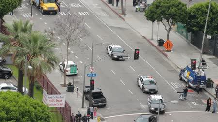 investigar : Police Caravan at Occupy March. LAPD follow protesters for the Occupy Movement in downtown Los Angeles, California on May 1st, 2012.