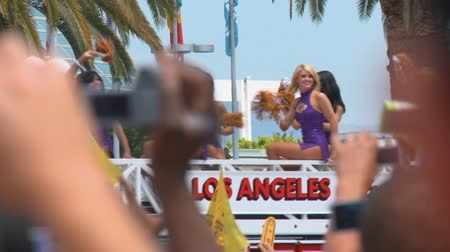 fanatics : Laker Girls on Fire Truck. Close on the Laker Girls dance squad atop an LAFD fire truck driving by the crowd at the LA Lakers NBA championship parade on June 21st, 2010, Los Angeles, California.