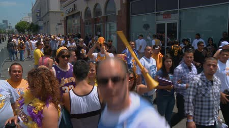 династия : Laker Fans Partying. Group of excited fans celebrating the seasons win following the 2010 LA   Lakers Championship parade on June 21st, 2010, Los Angeles, California.