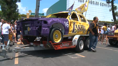 keeper : LAPD Lakers Car. And old cop car painted in the yellow, purple, and gold colors outside of Staples Center following the 2010 LA Lakers Championship parade on June 21st, 2010, Los Angeles, California. Stock Footage