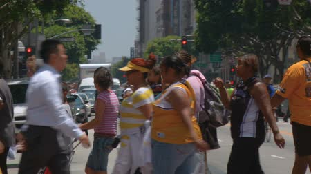 Laker Pedestrians, Medium Shot. Medium long shot of pedestrians and fans crossing the street after the 2010 Lakers championship parade in downtown LA. June 21st, 2010, Los Angeles, California.