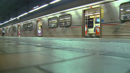 Subway Platform Time-lapse. Time-lapse of passengers entering and exiting a train on an underground subway platform in Los Angeles, California. Stock Footage