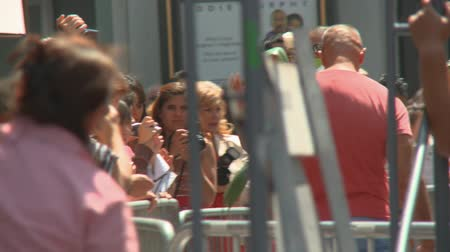Fans Photograph Jackson Memorial. Fans gather to remember Michael Jackson at his star on the Hollywood Walk of Fame the day after his death in Los Angeles, California on June 26th, 2009. Stock Footage