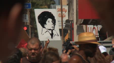 Michael Jackson Fan Art. A fan carries a tribute portrait at Michael Jacksons star on the Hollywood Walk of Fame the day after his death in Los Angeles, California on June 26th, 2009.