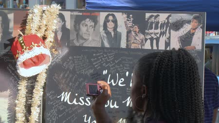 RIP Michael Jackson Fan Mural. Fans gather to remember Michael Jackson at his star on the Hollywood Walk of Fame three days after his death in Los Angeles, California on June 26th, 2009.
