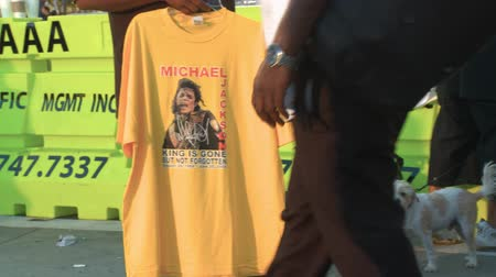 fama : Michael Jackson KING IS GONE T-Shirt. A street vendor sells memorabilia outside Michael Jacksons memorial service at LA LiveStaples Center in downtown Los Angeles, California on July 7th, 2009.