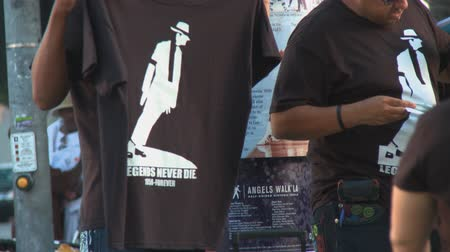 Michael Jackson LEGENDS NEVER DIE T-Shirt. Street vendors sell memorabilia outside Michael Jacksons memorial service at LA LiveStaples Center in downtown Los Angeles, California on July 7th, 2009.