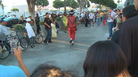 Michael Jackson Impersonator. A dancer performs for fans outside Michael Jacksons memorial service at LA LiveStaples Center in downtown Los Angeles, California on July 7th, 2009. Stock Footage