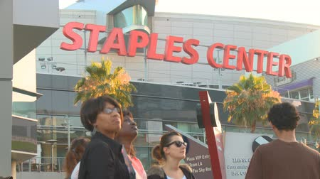 Staples Center Jackson Mourners. Fans watch a jumbotron outside Michael Jacksons memorial service at LA LiveStaples Center in downtown Los Angeles, California on July 7th, 2009. Stock Footage