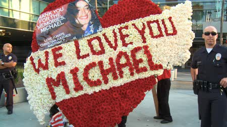 Crowd of Mourners at Jackson Memorial. Fans gather outside Michael Jacksons memorial service at LA LiveStaples Center in downtown Los Angeles, California on July 7th, 2009.