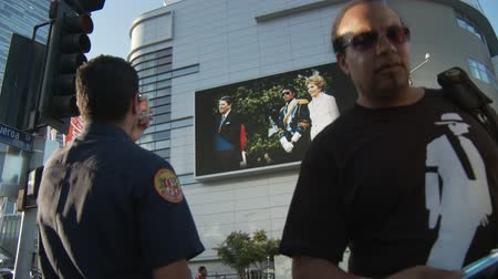 Fans at Michael Jackson Memorial. Fans watch a jumbotron outside Michael Jacksons memorial service at LA LiveStaples Center in downtown Los Angeles, California on July 7th, 2009.
