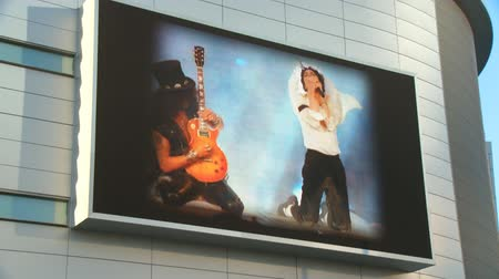 fame : Jumbotron at Michael Jackson Memorial. A slideshow plays outside Michael Jacksons memorial service at LA LiveStaples Center in downtown Los Angeles, California on July 7th, 2009. Stock Footage