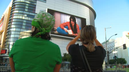 Fans Watch Jackson Memorial Slideshow. Two fans watch jumbotron outside Michael Jacksons memorial service at LA LiveStaples Center in downtown Los Angeles, California on July 7th, 2009.