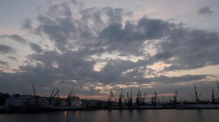tersane : Silhouette of several cranes in a harbor, shot during sunset. Odessa, Ukraine