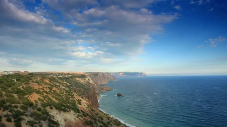 horizonte sobre a água : 4K. Cloudy sky over the mountains and the sea. Cape Fiolent, Crimea, Ukraine. FULL HD, 4096x2304. Stock Footage