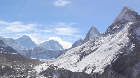 montar : Movement of the clouds on the mountains Everest, Gyazumba Glacier, Himalayas, Nepal. FULL HD Stock Footage