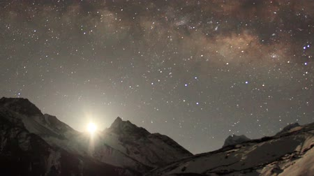 múló : Time lapse of the night sky with clouds and stars passing by behind mountain Taboche, Cholatse, Machhermo village. Nepal, Full HD Stock mozgókép