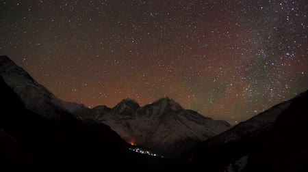 dole : Time lapse of the night sky with clouds and stars passing by behind mountain Kongde Ri, Dole village. Nepal, Full HD