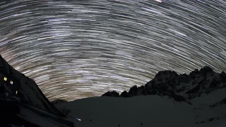 múló : Time lapse of the night sky with clouds and stars passing by behind mountains Pharilapche peak. Nepal, Full HD Stock mozgókép