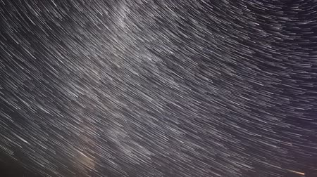 startrails : Starry sky over the lake Moiseevskoe, Valdaysky district, Novgorod region, Russia. Time-lapse. Full HD