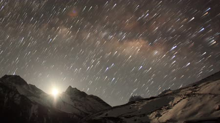dark sky : Time lapse of the night sky with clouds and stars passing by behind mountain Taboche, Cholatse, Machhermo village. Nepal, Full HD Stock Footage