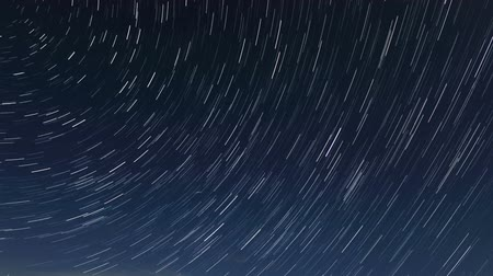 startrails : Night landscape, night sky with moving stars over the sea. Mountain Meganom, Crimea, Russia, Full HD,  (time lapse)