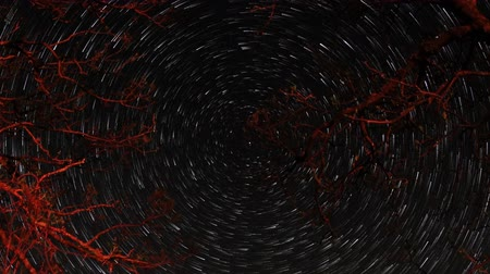 startrails : Time lapse of the night sky with clouds and stars passing by behind mountain. Sokolinoye, Grand Canyon of Crimea, Crimea, Russia. Full HD,