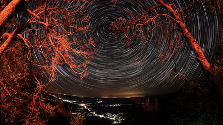 múló : Time lapse of the night sky with clouds and stars passing by behind mountain. Sokolinoye, Grand Canyon of Crimea, Crimea, Russia. Full HD,