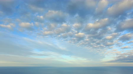 mavi gök : 4K. Cloudy sky over the sea (Time Lapse). Ultra HD, 4096x2304.