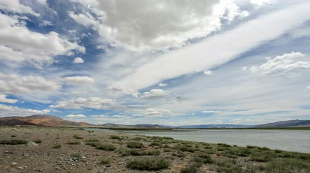 moğolistan : Clouds above the Khovd river, Mongolian Altai, Ulgii, Mongolia. Full HD Stok Video