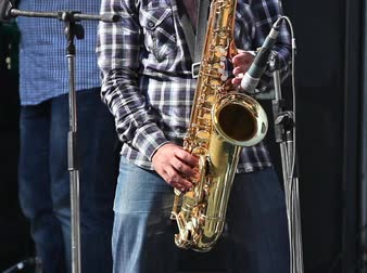 playing band : Man playing with saxophone on the concert Stock Footage