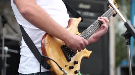 electric : Male guitar player performing song on instrument Stock Footage