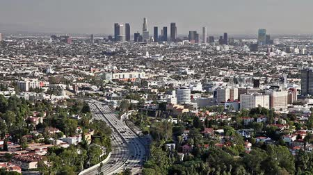 urban skyline : Los Angeles city view with traffic on freeway