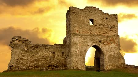 rycerz : Ruined gates of cossack castle at sunset