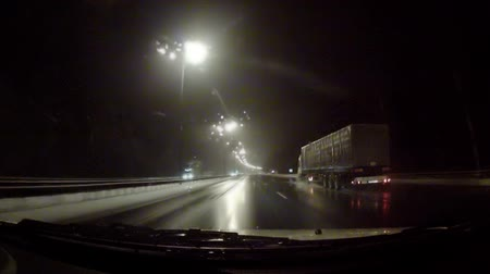 drive : Car moving on the night road through snowstorm