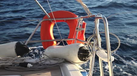 żaglówka : Lifebuoy on the yacht racing in the sea
