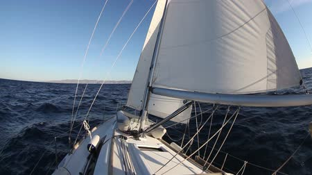 yelkencilik : Sailing yacht on the race in blue sea Stok Video
