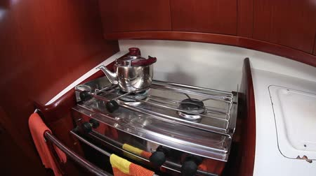 caboose : Kettle on the gas stove in yacht cook room, sailing boat