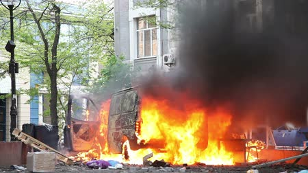 ruiny : Burning car in the center of city during unrest in Odesa, Ukraine