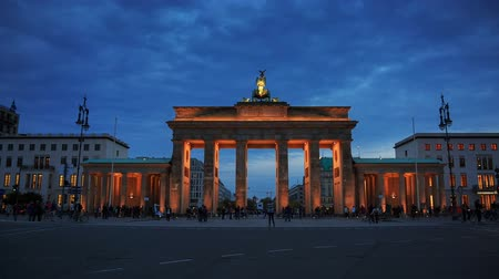 berlin skyline : Brandenburg gates in Berlin with crowd and urban transport timelapse