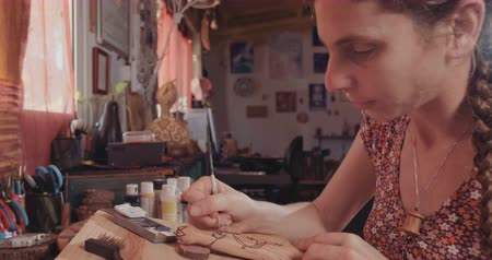 pallette : Artist painting and decorating a wooden buddhist prayer wheel