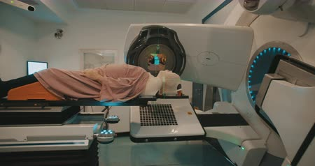 tomography : Patient getting Radiation Therapy Treatment inside a modern radiotherapy room
