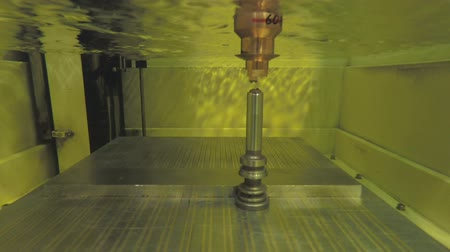 işlenmiş : Precision cutting of metal parts using an Electrical discharge machine Stok Video