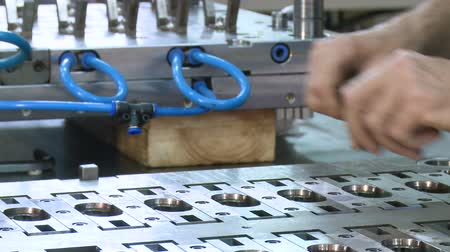 složka : hands of engineer assembling metal parts