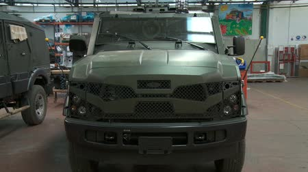 armoured : Israel, Circa 2011 - Armored vehicles manufacturing in a large factory Stock Footage