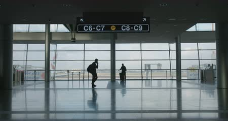 departure : silhouette of People in airport terminal walking with luggage