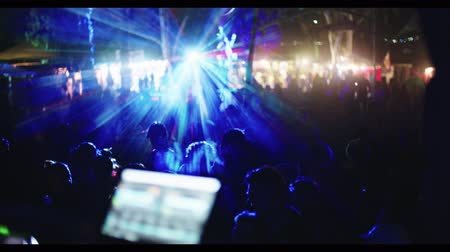 marijuana : DJ playing in a large trance party with large crowd of people dancing